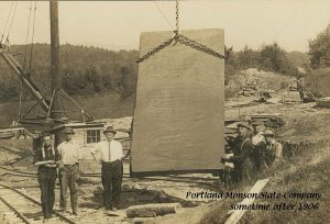 Large piece of slate being hoisted at the Portland Monson Slate Company circa 1906